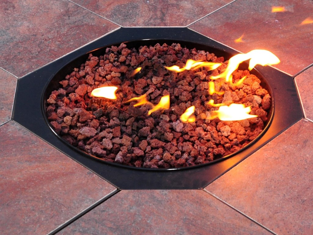 Real Fire Flames have Adjustable Flame Height and Sit Atop Decorative Lava Rocks
