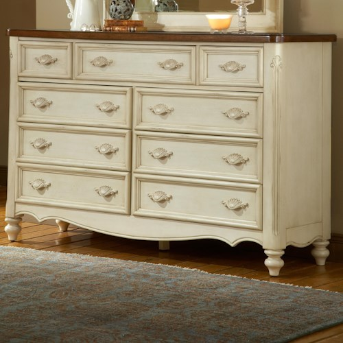 American Woodcrafters Chateau Nine Drawer Triple Front Dresser