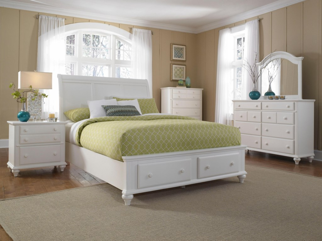 Dresser Shown with Chest, Mirror, Sleigh Headboard and Storage Footboard Bed, and Night Stand