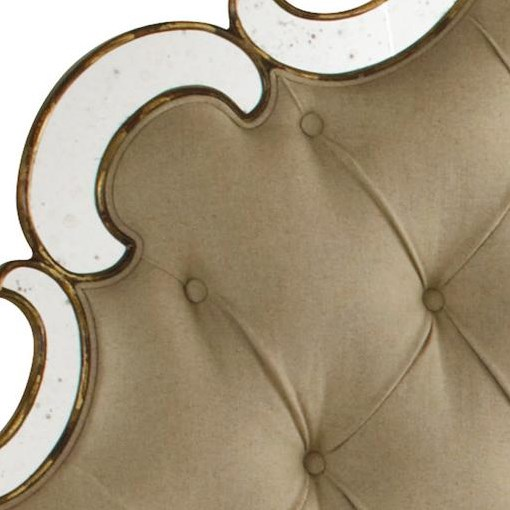 Crescent-Shaped Mirrors Beautifully Outline the Button-Tufted Headboard