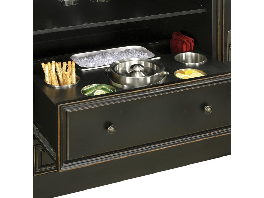 Center pull-out drawer includes a stainless steel, double-walled ice bucket with cover; two double-walled wine bottle coolers; two condiment bins; a multi-use rectangular bin; and additional space for miscellaneous items.