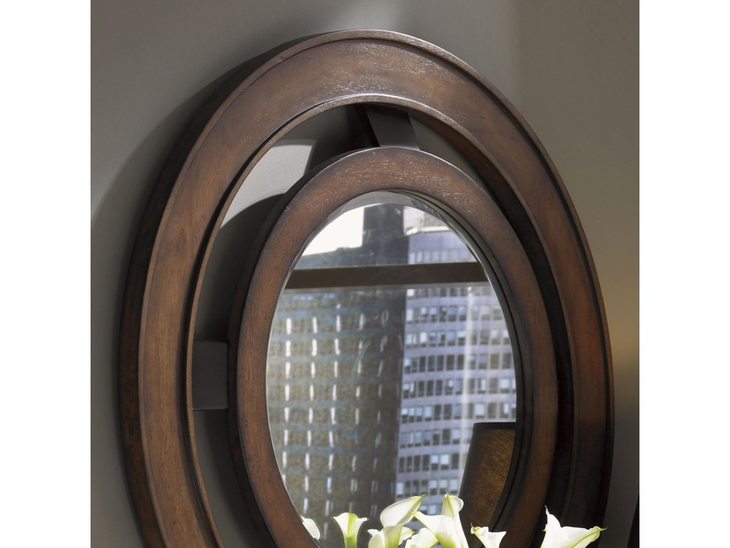 Concentric Wood Rings Are Raised at Different Levels For Added Dimension and Interest