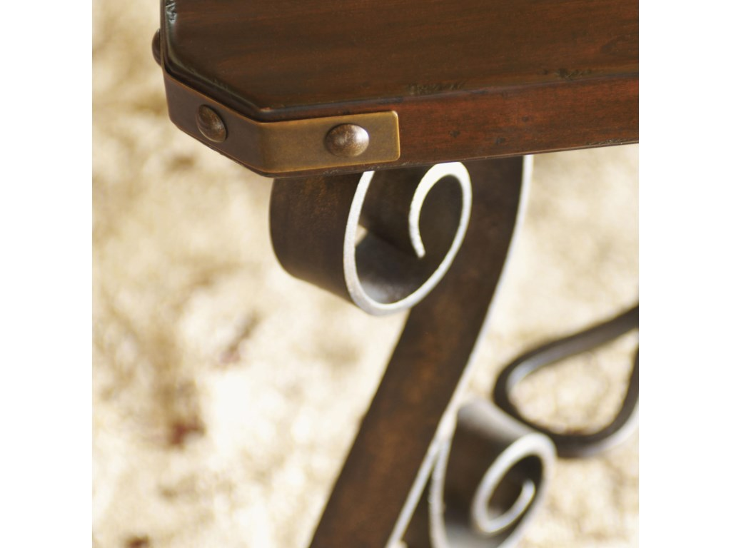Hand-Forged Iron Scrollwork and Decorative Corner Brackets Add to the Sense of Craftsmanship