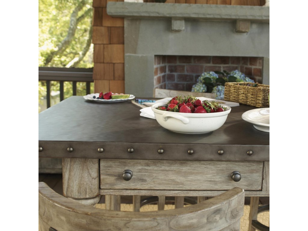 A Hammered Stainless Steel Top with Pewter Nail Head Trim Brings the Essence of French Laundry Styling to the Shelter Island Bistro Table