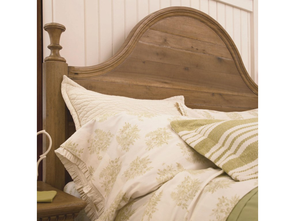 Detail of Camel-Sloped Headboard with Panel Detailing and Wood Finial Posts