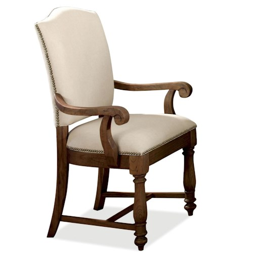 Riverside Furniture Castlewood Upholstered Dining Arm Chair with Nailhead Trim and Wooden Base