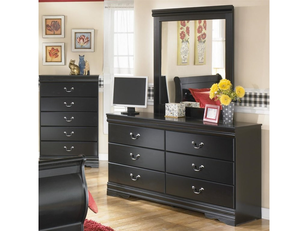 Dresser Shown with Mirror and Chest in Background.