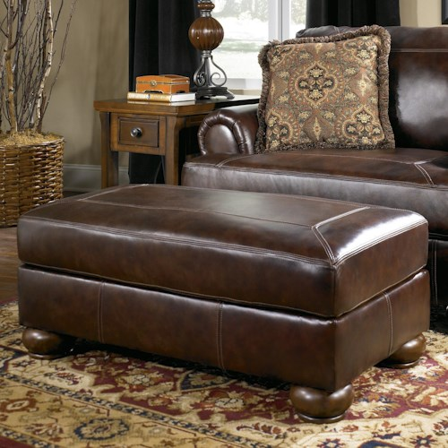 Signature Design by Ashley Axiom - Walnut Traditional Ottoman with Bun Wood Feet