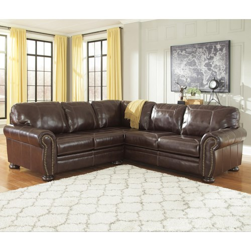 Signature Design by Ashley Banner 2-Piece Leather Match Sectional with Rolled Arms, Nailhead Trim, & Bun Feet