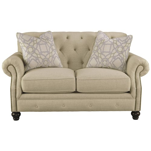 Signature Design by Ashley Kieran Traditional Loveseat with Tufted Back and Feather Blend Accent Pillows