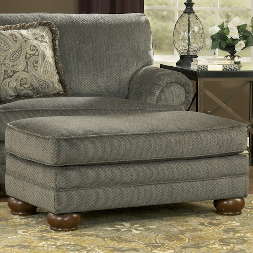 Signature Design by Ashley Parcal Estates - Basil Traditional Ottoman with Wooden Bun Feet