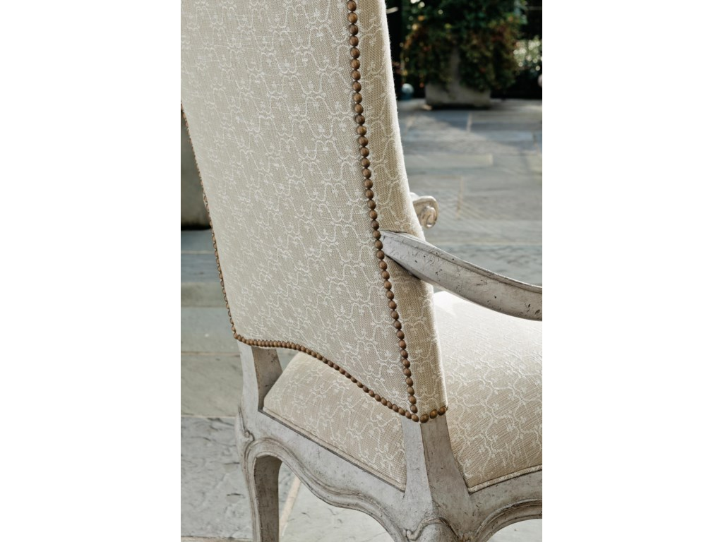 The chairs feature the regal Monarque fabric and classic nailhead trim