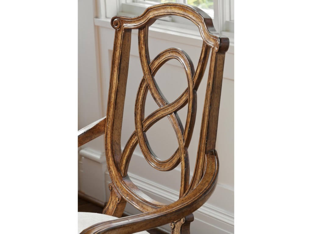 Detailed carving and a classical shape lend the Tuileries Arm Chair a timeless appeal