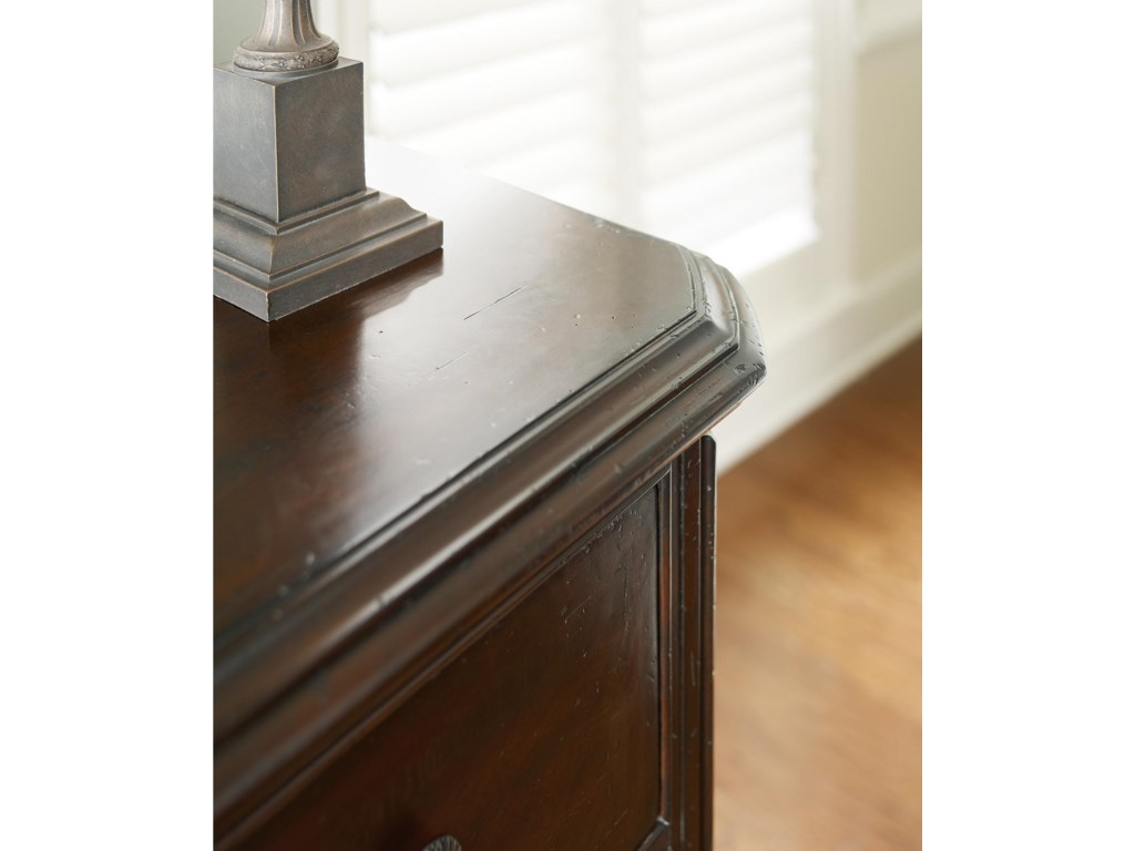 Canted corners and distressing details invitingly soften the bow front profile of the Triple Dresser.
