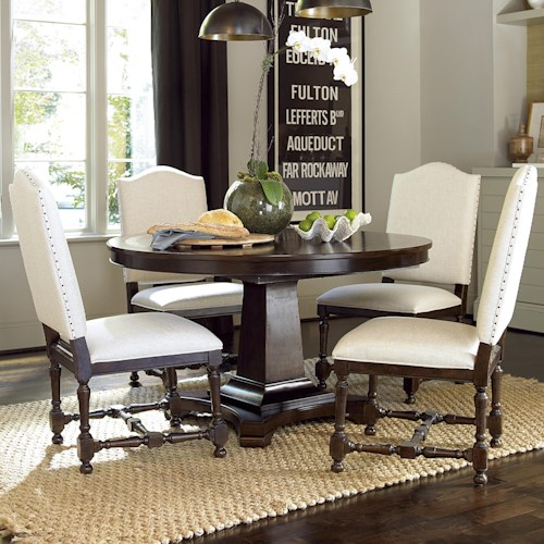Universal Proximity Round Dining Table with Upholstered Side Chairs