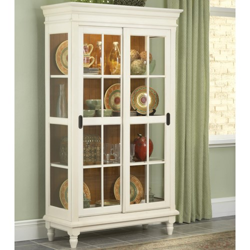 Whitewood Dining Room Pieces Curio Cabinet with Crown Moulding, Turned Feet, and Sliding Glass Doors