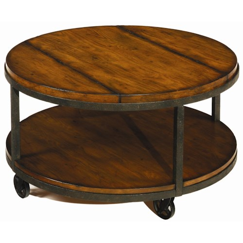 Hammary baja round cocktail table with shelf and wheels What to put on a round coffee table