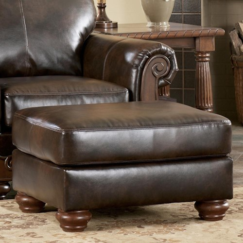 Signature design by ashley barcelona antique ottoman for Ivan smith furniture