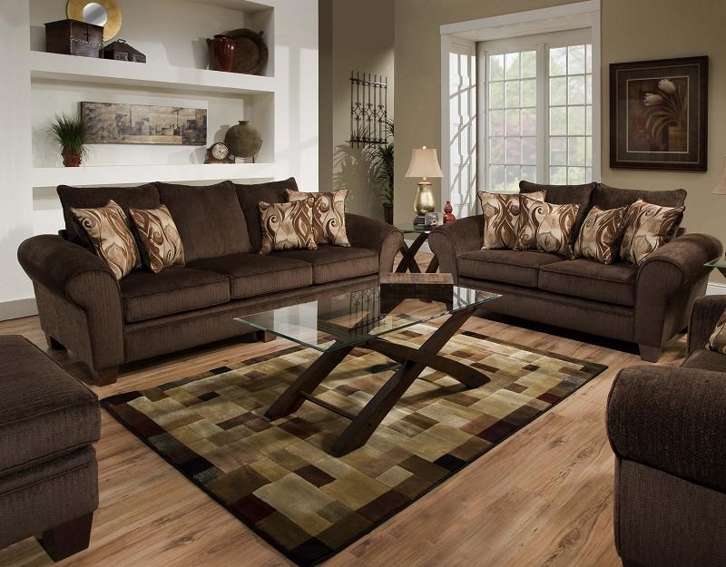 Living Room Setting with Ottoman and Chair Partially Pictured