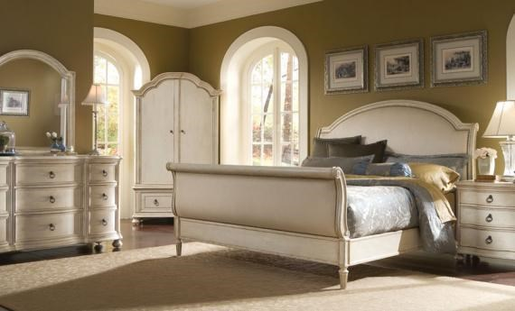 Shown with Triple Dresser, Wardrobe, Upholstered Sleigh Bed and Drawer Night Stand