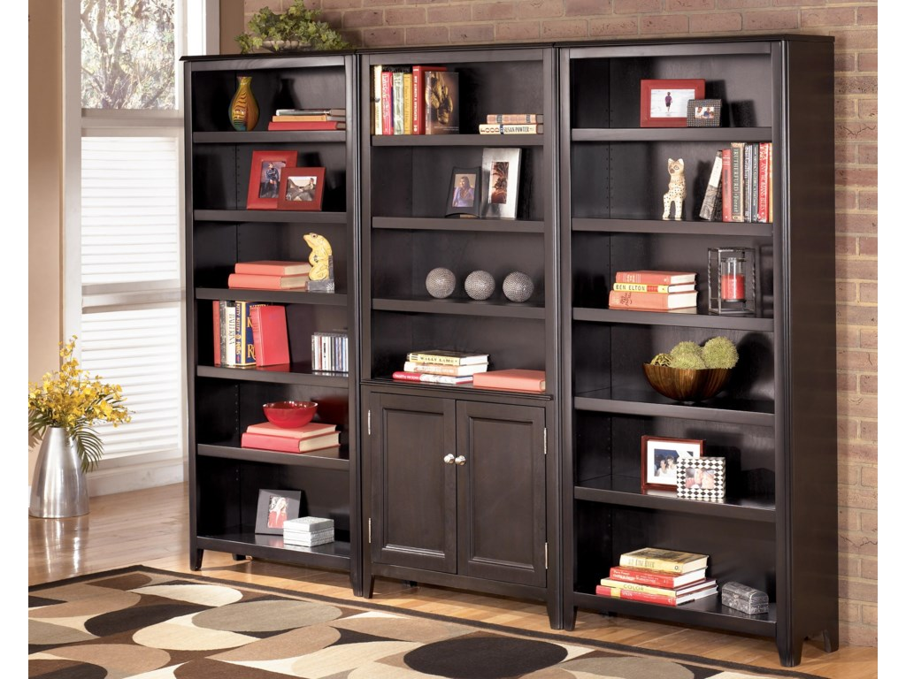 2 Large Bookcases Shown with 1 Large Door Bookcase