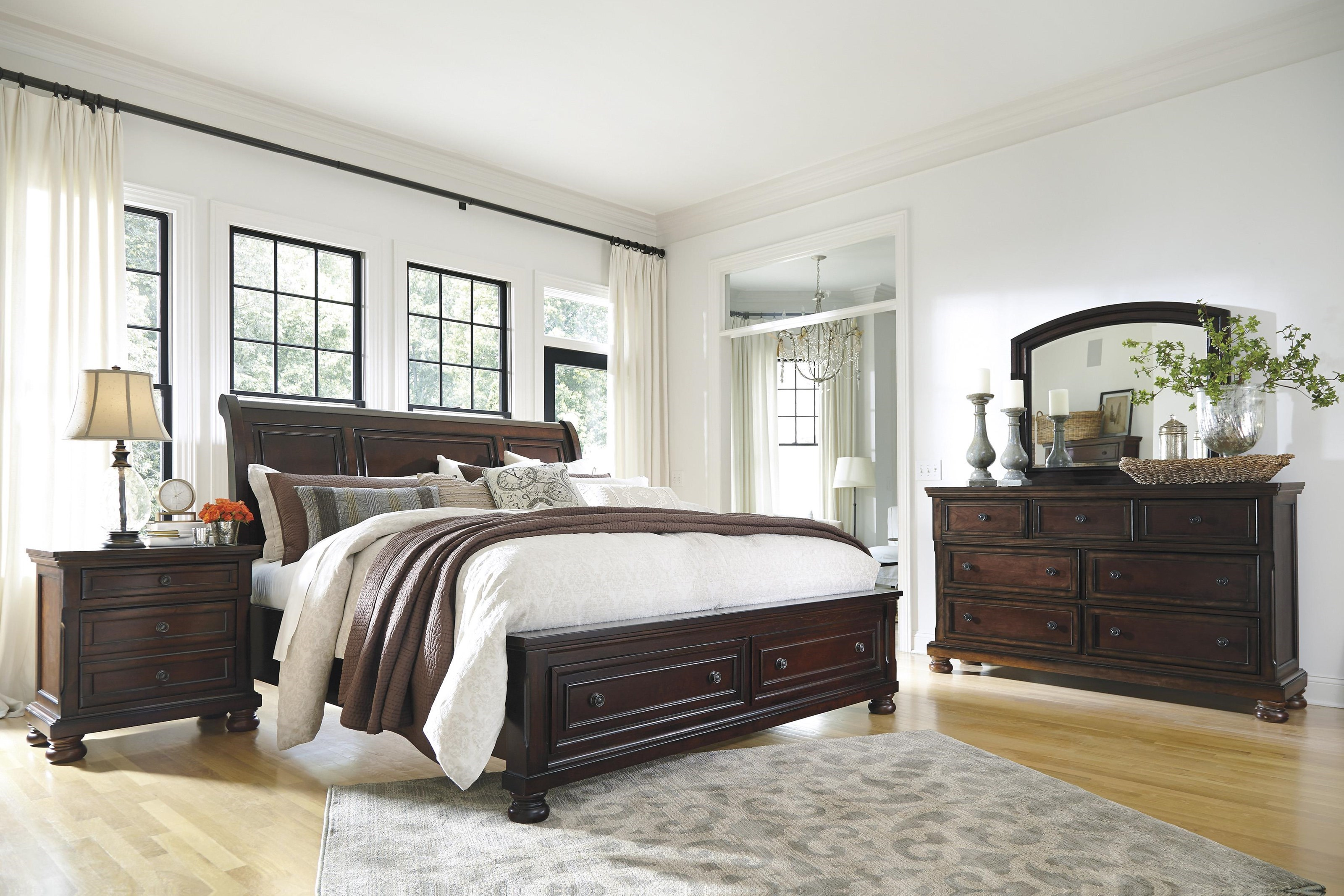 Picture of: Ashley Furniture Porter B697 77 74 98 31 36 Queen Sleigh Bed With Storage Dresser And Mirror Package Sam Levitz Furniture Bedroom Groups