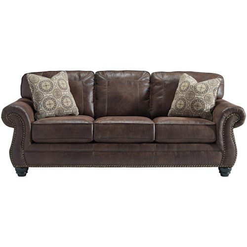 Benchcraft Breville Faux Leather Sofa With Rolled Arms And Nailhead Trim
