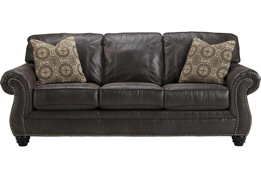 Breville Faux Leather Sofa with Rolled Arms and Nailhead Trim by Benchcraft  by Ashley at Coconis Furniture & Mattress 1st