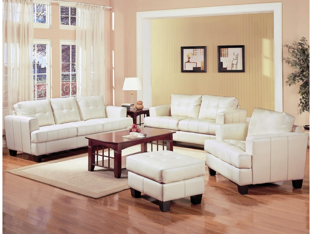 Shown in Room Setting with Sofa, Ottoman, and Chair