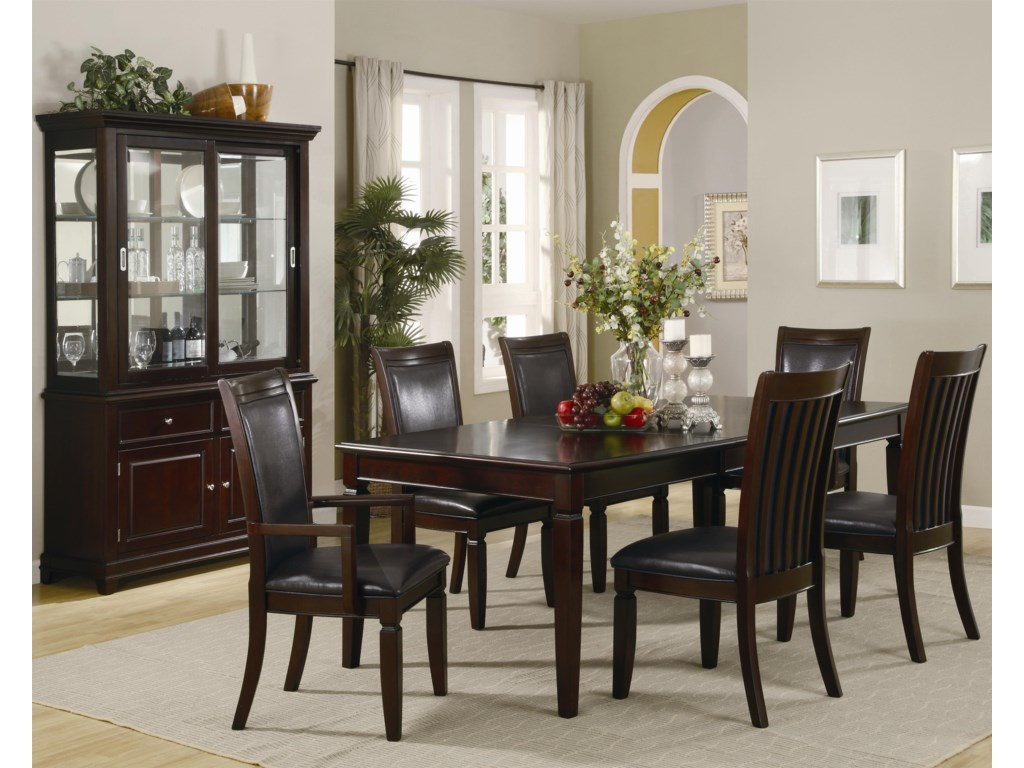 Dinner Table Shown in Room Setting with Buffet and Hutch as well as Side and Arm Chairs