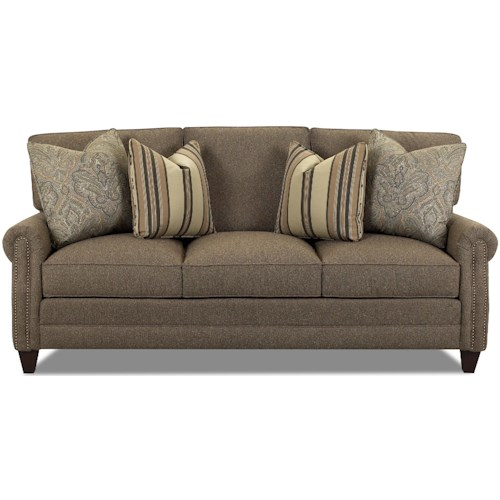 Comfort Design Camelot Studio Fabric Sofa with Exposed Wooden Legs and Nailhead Accent