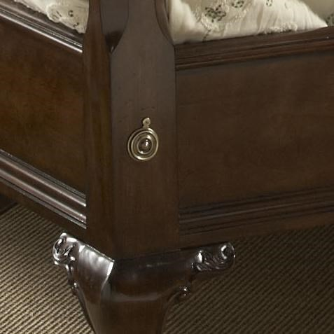 The Low Footboard Features Metal Rosettes and a Wood Base