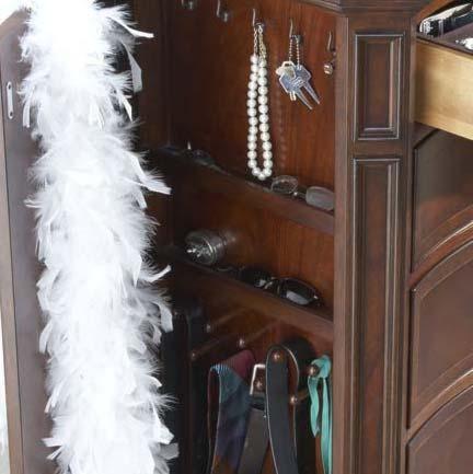 Compartment Behind Hidden Panel Door Contains Necklace Hooks and Necktie Pegs