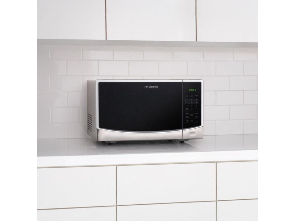 Microwave Sits on Kitchen Countertop