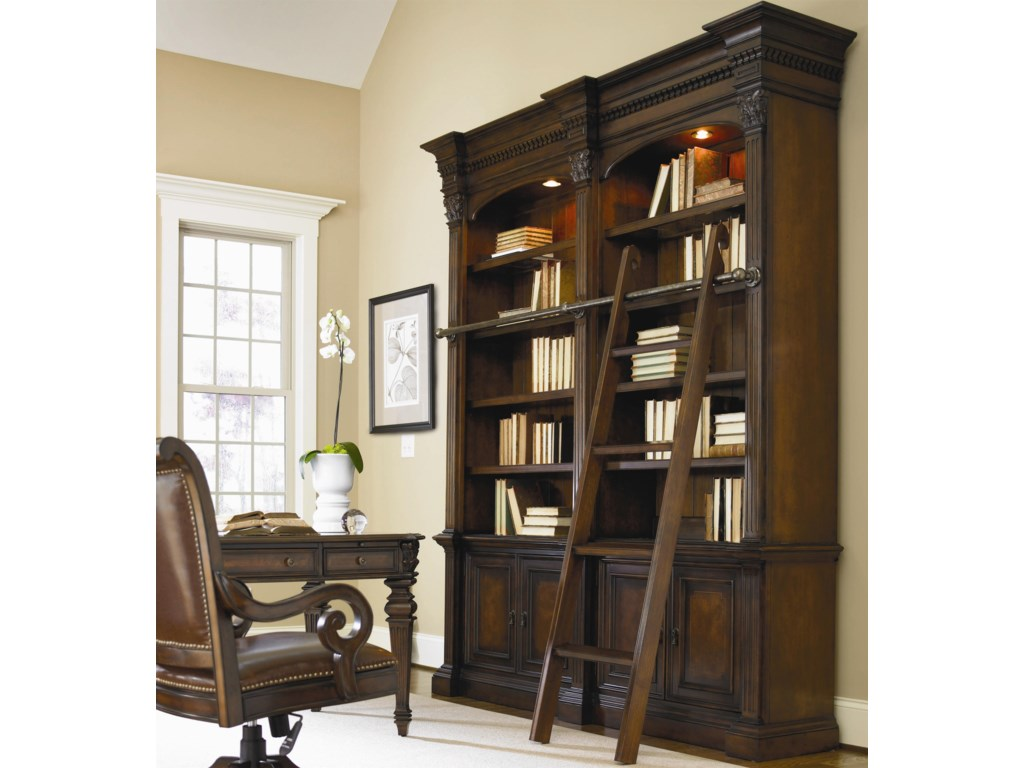 Swivel Chair Shown in Room Setting with Open Bookcase and Ladder