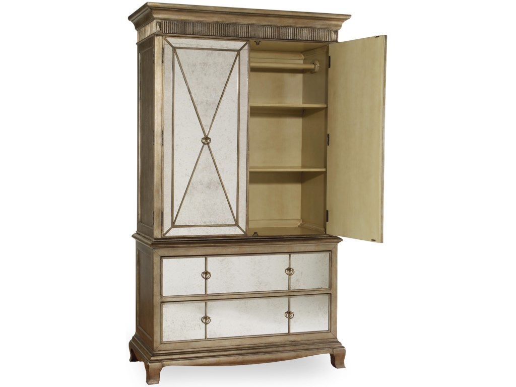 Armoire Includes Two Doors, Two Shelves, a Clothing Rod, and Two Self-Closing Drawers