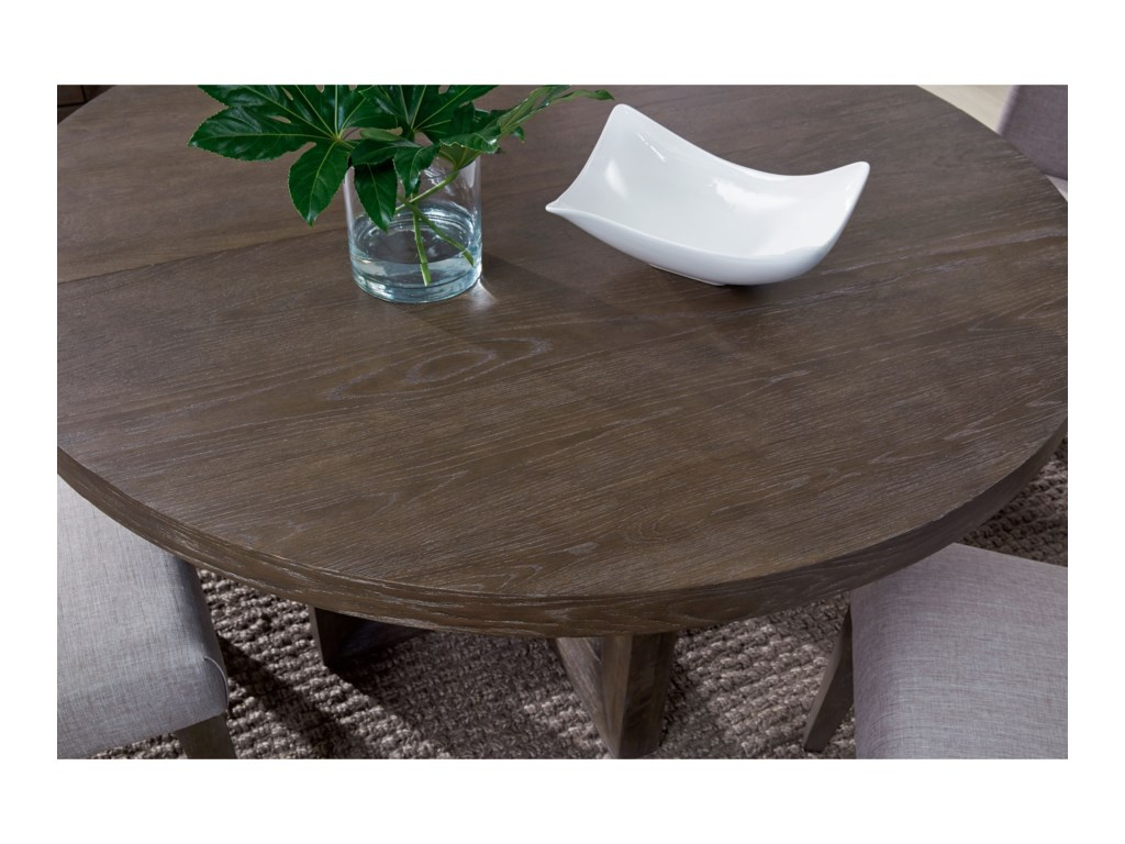Legacy Classic FacetsRound to Oval Pedestal Dining Table