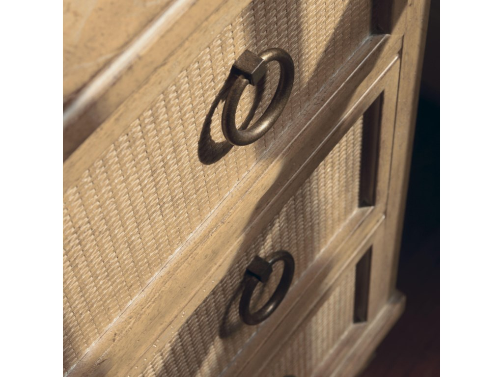Hardware Features a Ring Design with Burnished Bronze Finish with a Woven Rattan Drawer Front