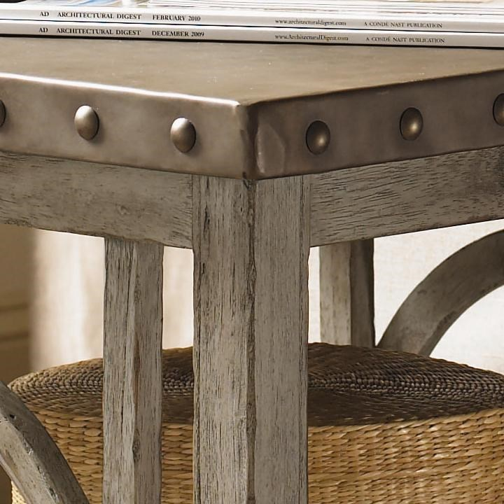 The Hammered Stainless Steel Top with Pewter Nail Head Trim Brings the Essence of French Laundry Styling to the Wyatt Lamp Table