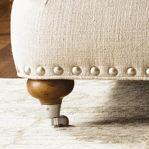 The Pewter Nail Head Trim Showcases the French Laundry Design, While Bun Feet with Casters Complete the Piece