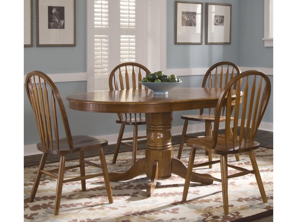 Oval Pedestal Table Shown with Arrow Back Windsor Slide Chairs