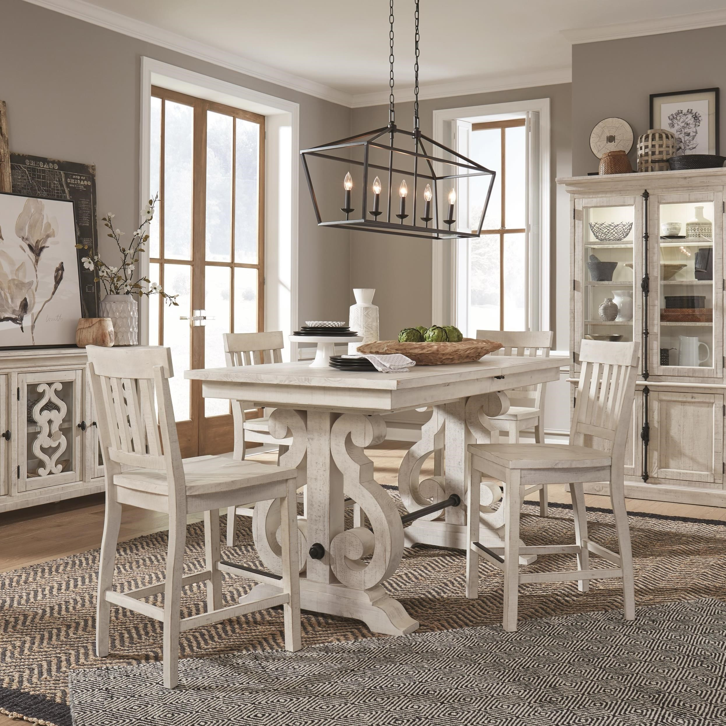 Picture of: Magnussen Home Bronwyn 5 Piece Farmhouse Counter Height Dining Table Set With Bar Stools Reeds Furniture Pub Table And Stool Sets