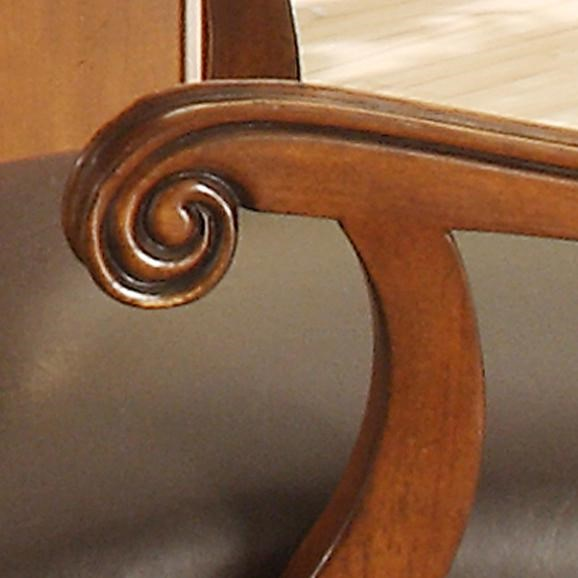 Ornate Design in Wooden Arm of Desk Chair