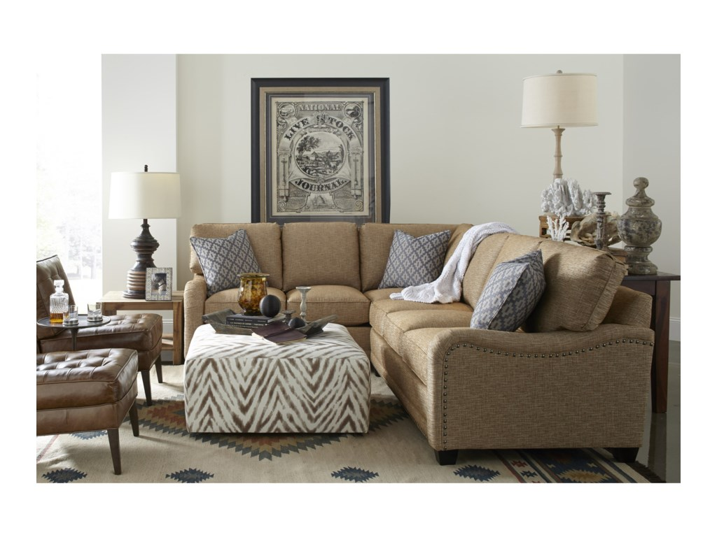 Shown with nailhead trim and additional throw pillows available through premium options.