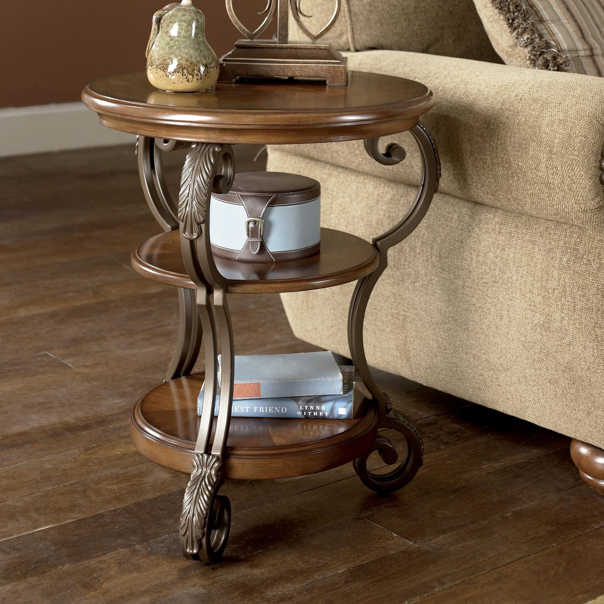 Picture of: Signature Design By Ashley Nestor Round Chairside End Table Royal Furniture End Table