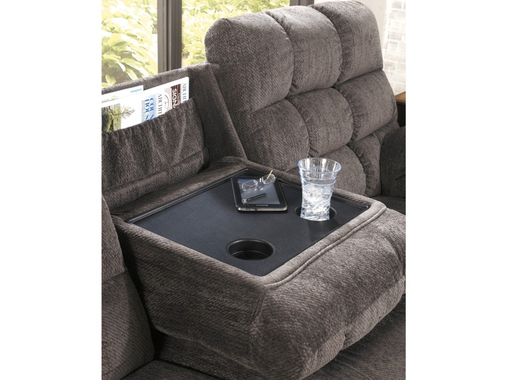 A Drop-Down Table-Top in the Sofa's Center Cushion Provides a Holder for Magazines, Beverages and Snacks
