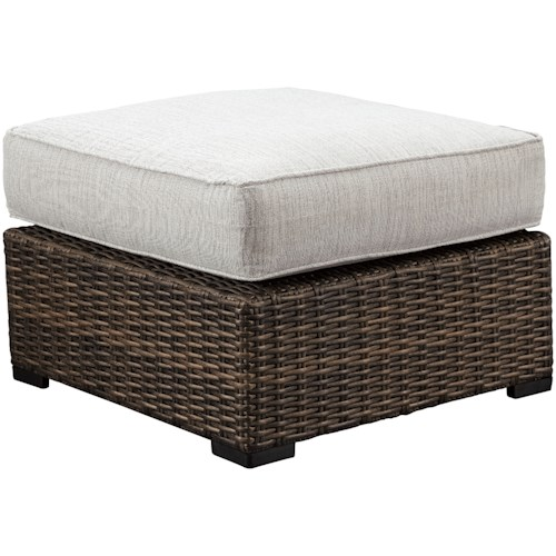 Signature Design by Ashley Alta Grande Wicker Ottoman with Cushion