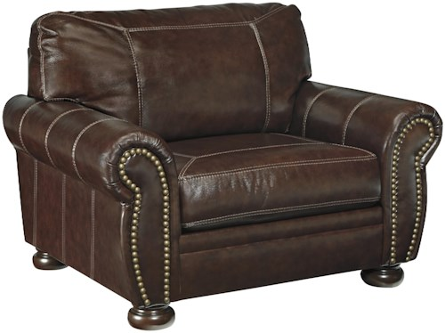 Signature Design by Ashley Banner Traditional Leather Match Chair and a Half with Rolled Arms, Nailhead Trim, & Bun Feet