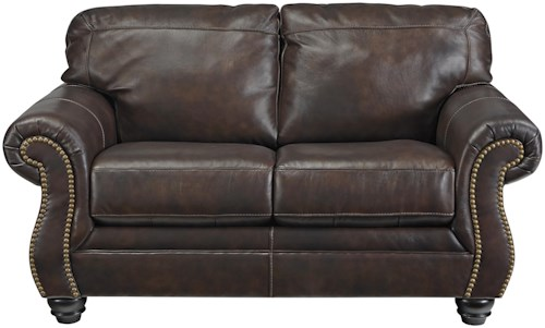 Signature Design by Ashley Bristan Traditional Leather Match Loveseat with Rolled Arms & Nailhead Trim