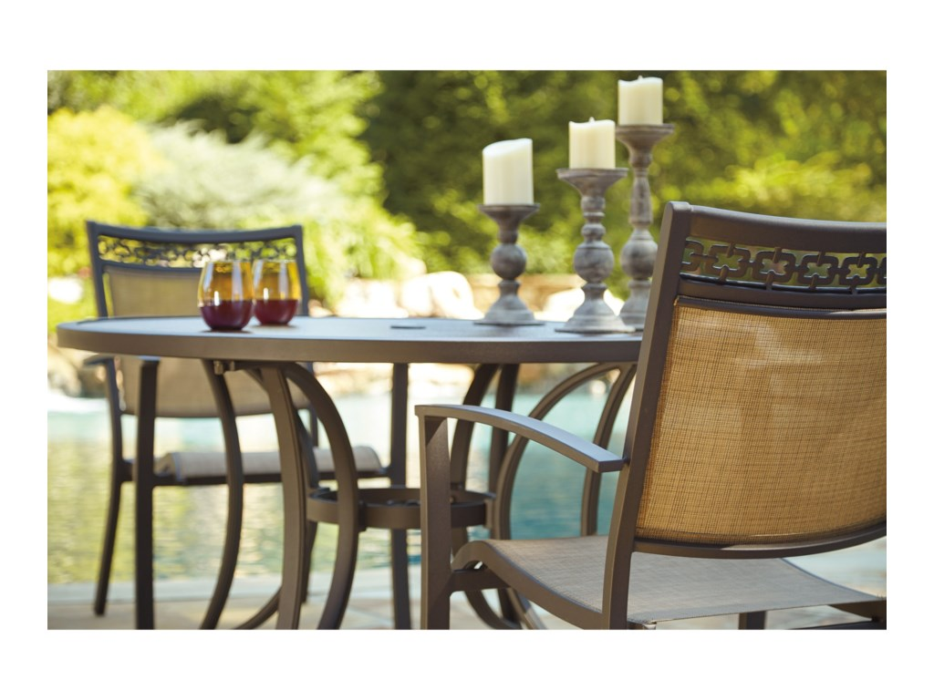 Signature Design by Ashley CarmadeliaOutdoor Round Dining Table Set